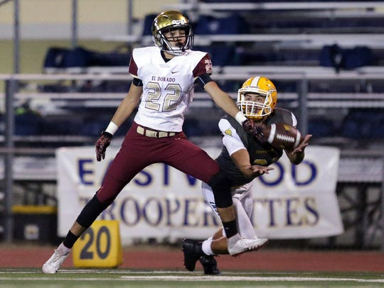 Eastwood wide receiver Noah Rios tries to make a diving