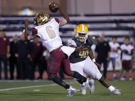 Eastwood defensive lineman Jamari Bullock chases El