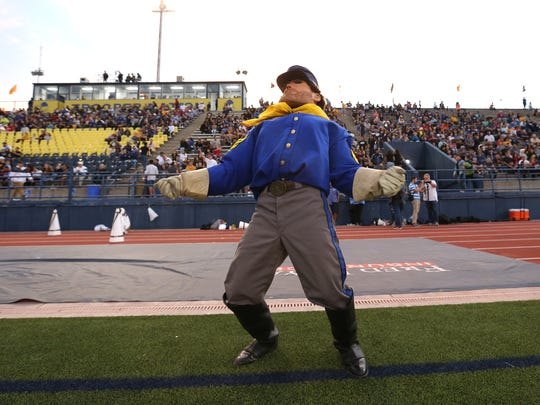 Sarge dances to the El Dorado marching band before their game Friday night at Eastwood High School.