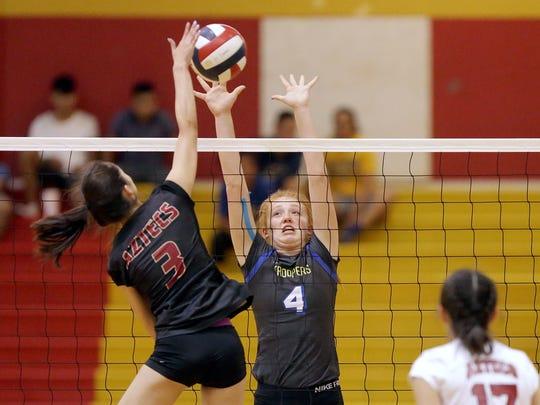 Eastwood's Kaleigh Thomas tries to block a hit from El Dorado's Brianna Valdez Tuesday night at El Dorado High School.