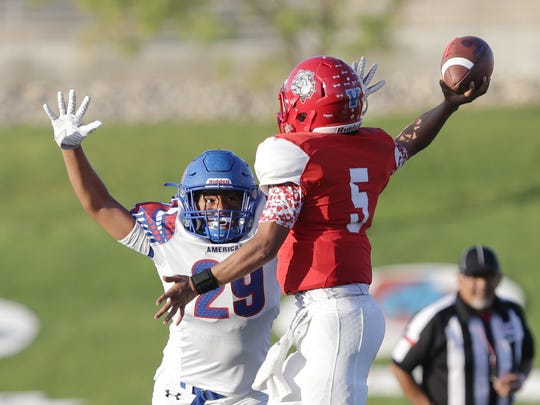 Americas' Edgar Ortiz blocks a passing attempt by Socorro quarterback Jacob Luna Friday at the SAC.