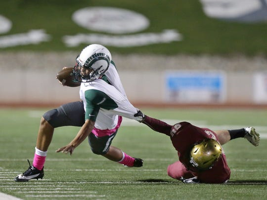 Montwood quarterback Andrew Fernandez is dragged down by El Dorado tackle Nicholaus Valenzuela Friday night at the SAC.