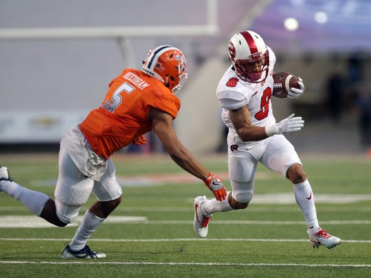 Western Kentucky wide receiver Kylen Towner tries to beat UTEP's Nik Needham to the corner Saturday in the first half of their game at the Sun Bowl.