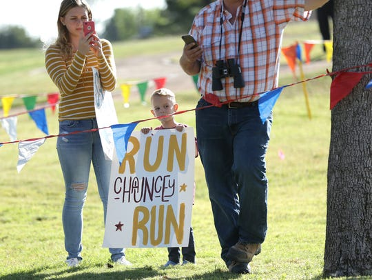 Family and friends cheer on their runners Thursday