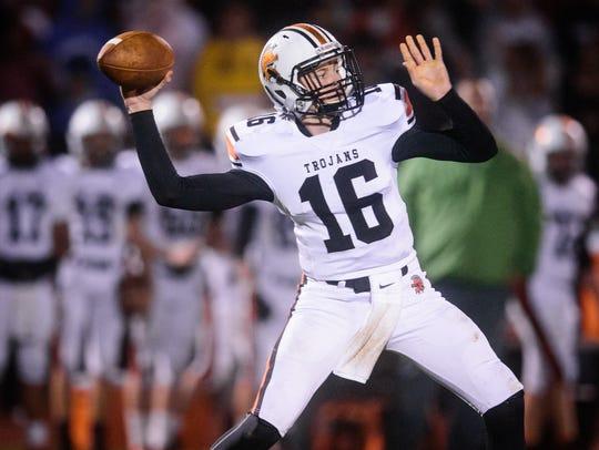 York Suburban quarterback Max Reinecker (16) drops