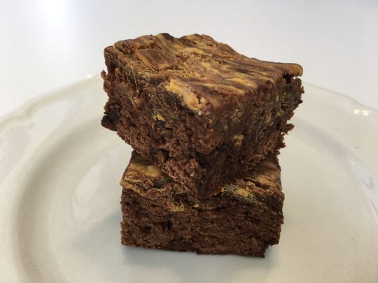 Pumpkin Swirl Brownies are made with box brownie mix and canned pumpkin