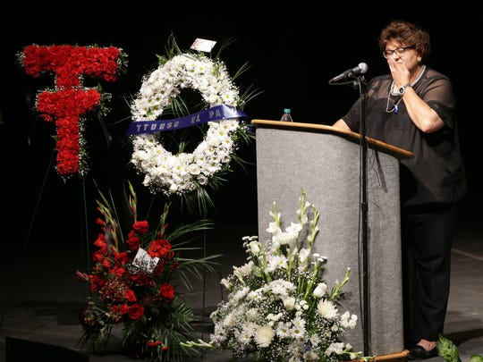 Angie Escarciga wipes a tear from her eye as she speaks about Texas Tech University police Officer Floyd East Jr. on Tuesday at the Abraham Chavez Theatre. A memorial for the officer killed in Lubbock was held in El Paso, his hometown.