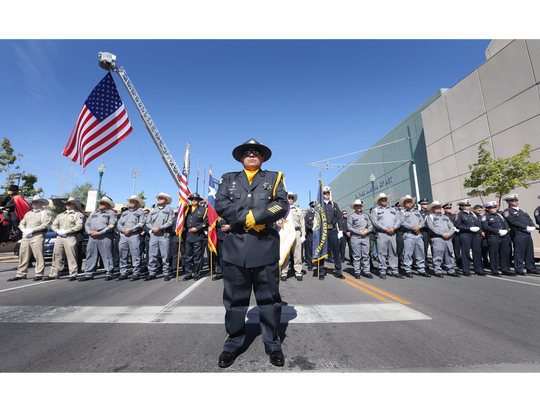 Law enforcement officers attend a memorial service