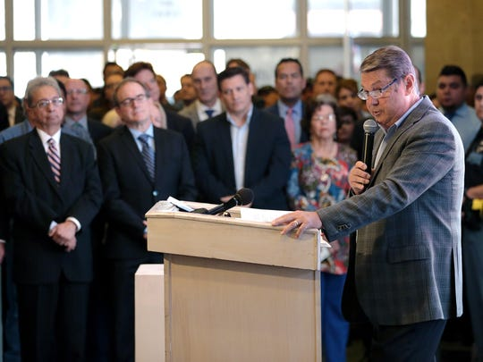 Burt Blacksher, chairman of the Housing Authority of the City of El Paso board of commissioners, speaks at a Wednesday event inside the Blue Flame building that launched the renovation of the former office building into an apartment complex.