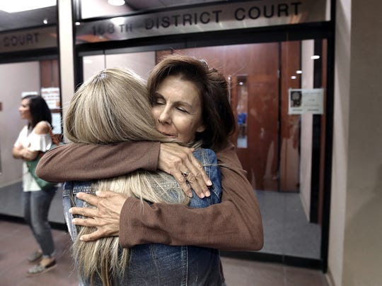 Monica Broadstreet and Valerie Green embrace after a hearing in the 168th District Court for Jan Michael Nieves Delgado, who was convicted of killing their husbands, Jimmy Joe Broadstreet and James Green, in May 2014. Nieves was convicted of manslaughter, given probation and ordered to pay restitution. Nieves set up a GoFundMe account to help him pay his restitution, which upset the victims' families.