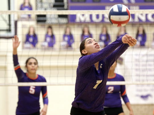 Savannah Marenco of Burges passes from the back during their bi-district game Tuesday against Eastlake.