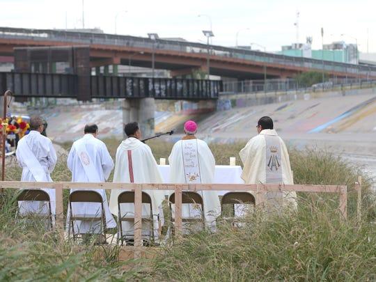Bishop Mark Seitz holds mass during the Border Mass