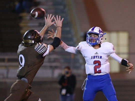 Austin's Taylor Bickerstaff rushes Irvin Quarterback