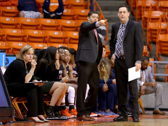 UTEP head women's basketball coach Kevin Baker, right, talks with assistant coach Michael Madrid during their game against CSU Bakersfield in November.