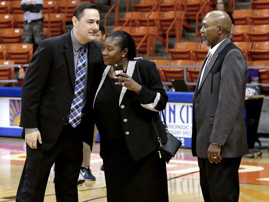 UTEP women's head basketball coach Kevin Baker hugs the parents of former player Keneque Chancellor who was killed in a plan crash in Hatch. UTEP held recognized Chancellor before Saturday's game against CSU Bakersfield.