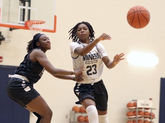 UTEP's Jakeira Ford passes to a teammate as they practice for the Thanksgiving Classic Basketball Tournament Wednesday.