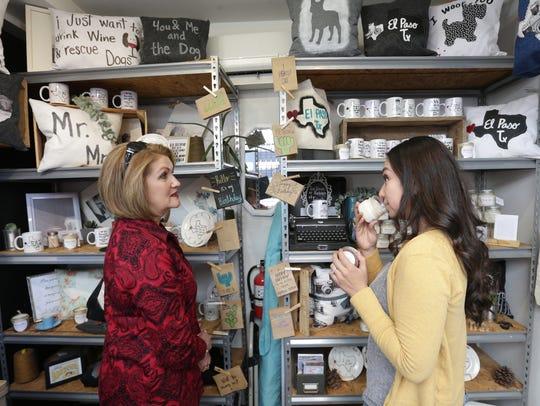 Jhon Estrada, left, and Melanie Garay shop at Trendy