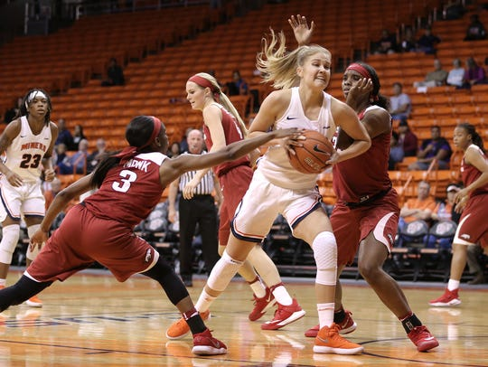 UTEP's Zuzanna Puc drives to the hoop guarded by Malica
