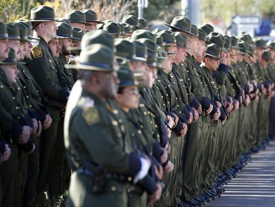 U.S. Border Patrol agents line Nashville Street outside