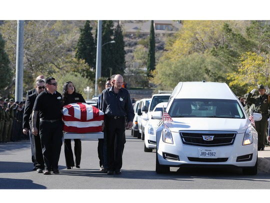 Pall bearers carry Border Patrol agent Rogelio Martinez in to Our Lady of Guadalupe Church in Central El Paso for a funeral Mass on Nov. 25.