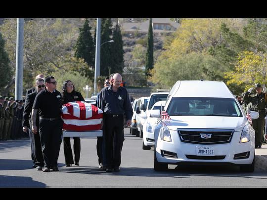 Pall bearers carry Border Patrol agent Rogelio Martinez
