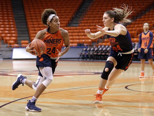 UTEP's Rachel Tapps, left, drives to the basket covered