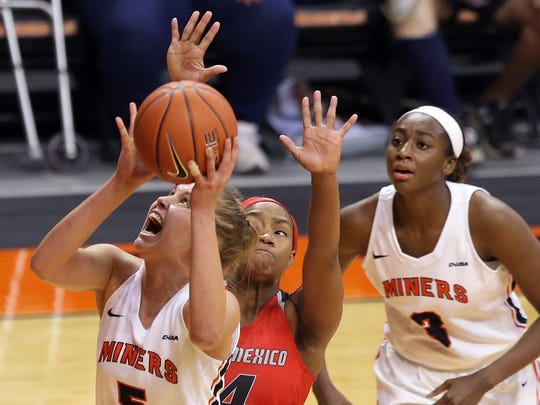 UTEP's Zuzanna Puc goes to the basket covered by UNM's Alex Lapeyrolerie Thursday at the Don Haskins Center.