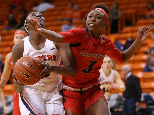 UTEP's Jordan Alexander is covered closely by UNM's N'Dea Flye in the first half of their game Thursday at the Don Haskins Center.