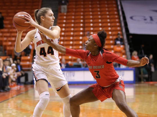 UNM's N'Dea Flye guards UTEP's Katarina Zec on the perimiter during the first half of their game Thursday at the Don Haskins Center.
