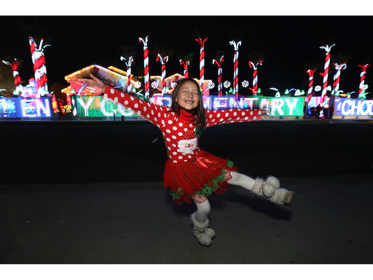 Seven-year-old Renata Ozaeta dances and twirls as she awaits the first show outside the home of Fred Loya, owner of Fred Loya Insurance, in 2017. The seven-minute light show is set to Christmas music. Here are the times for the light shows in 2018: 6, 7 and 8 p.m. Fridays, Saturdays and Sundays, Dec. 14 through Dec. 23. Also 6, 7 and 8 p.m. Dec. 24 and Dec. 25.