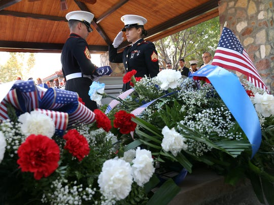 The Marine honor guard folds the casket flag for retired