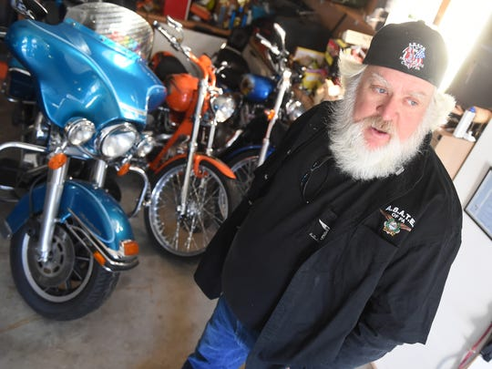 John Kruger, an Adams County resident and a former EMT, says he's choosing the safer option by riding without a helmet. Kruger thinks he's more likely to avoid an accident and better able to react if someone does hit him.