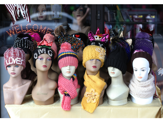 A store lures customers with cold weather accessories along El Paso Street in Downtown El Paso.