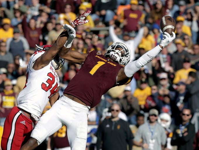Arizona State wide receiver N'Keal Harry, right, makes