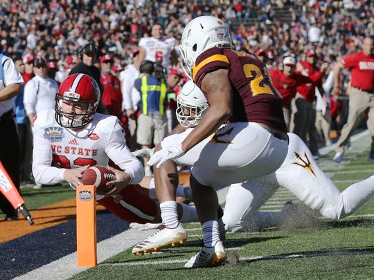 North Carolina State defeated Arizona State 52-31 in