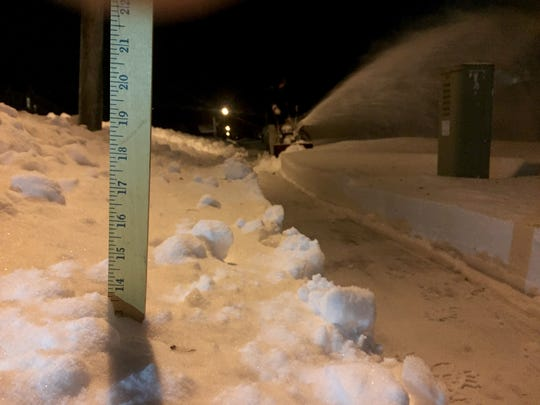 The snow depth is measured with an Asbury Park Press