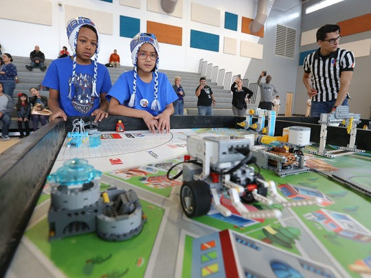 Lujan Chavez fourth graders Peyton Hart, left, and Grace Ponzio watch as their robot sets off on tasks during the SISD Robocom 4.0 competition at Pebble Hills High School.