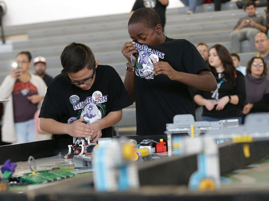 Kenneth Frazier Brown reacts after his team's robot went off course Saturday at the SISD Robocom 4.0 as teammate Mauricio Munoz troubleshoots.