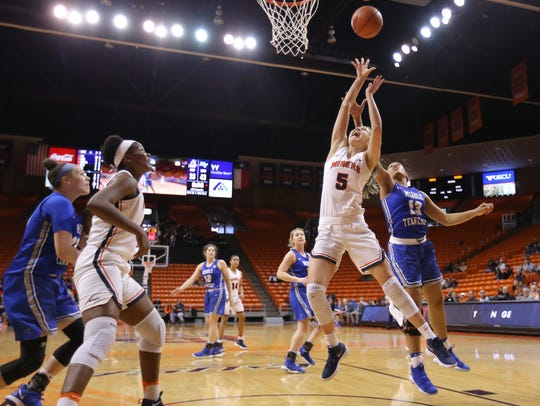 UTEP's Zuzanna Puc is fouled by Middle Tennessee's