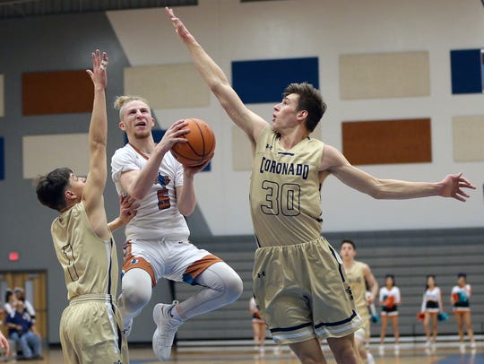 Pebble Hills' Austin Brown tries to shoot covered by