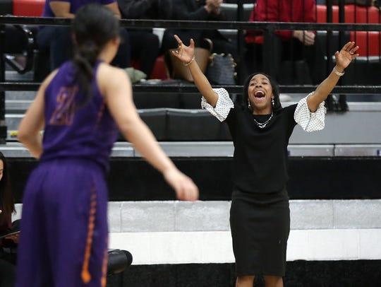 Eastlake coach Joi Woodard yells instructions to her