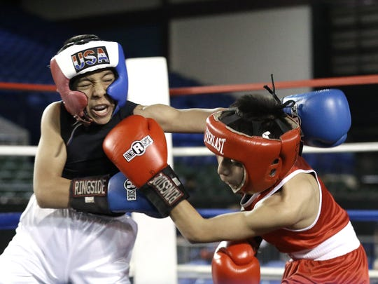 Michael Gomez of LC Pal Boxing ducks a punch from Marco Sanchez on his way to winning their bout Saturday at the Golden Gloves tournament at the El Paso County Coliseum.
