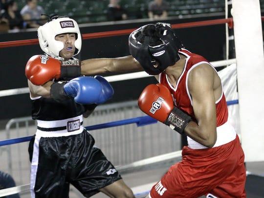 Jorge Madrid, right, of the Palomas Mexico Boxing Club
