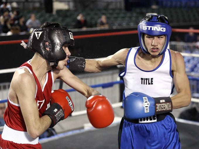 Diego Monclova of the Alpine Boxing Club, right, connects