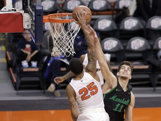 UTEP's Keith Frazier has his dunk blocked by Marshall's Ajdin Penava in the second half of their game Saturday at the Don Haskins Center.