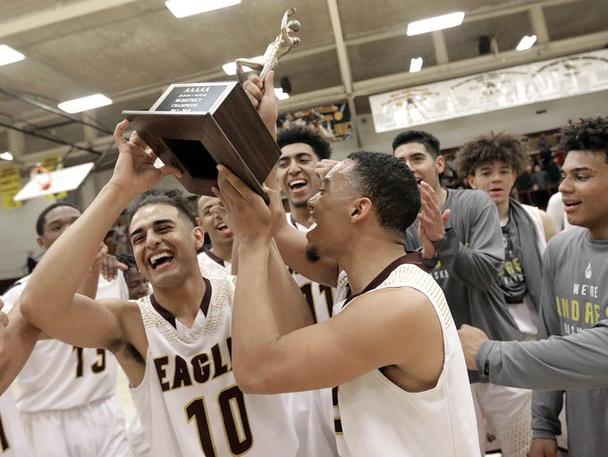 Andress celebrates with their bi-district championship