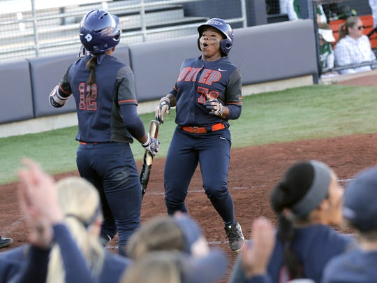 UTEP's Pamala Baber celebrates her run with teammate Mariah Ellis as the Miners run-rule Portland State Friday at Helen of Troy Field.