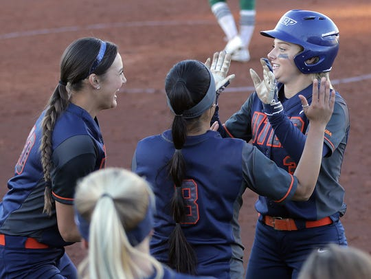 UTEP's Courtney Clayton, right, celebrates her game-winning