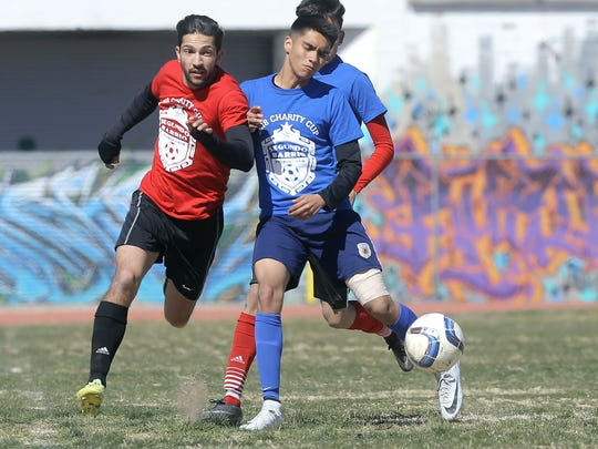 The Panthers adult team takes on the Segundo Barrio Futbol Club in a charity soccer match Saturday at Guillen Middle School. The matches pitted local leaders against the Segundo Barrio Futbol Club's 17 and under and 15 and under teams.
