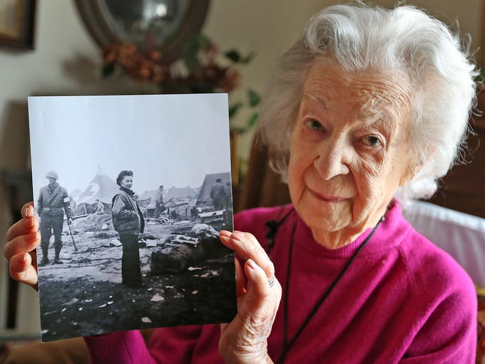 "Marian ""Nan"" Somes shows a photo, Thursday, Feb. 7,"